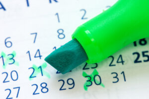Close up of a calendar and green marker